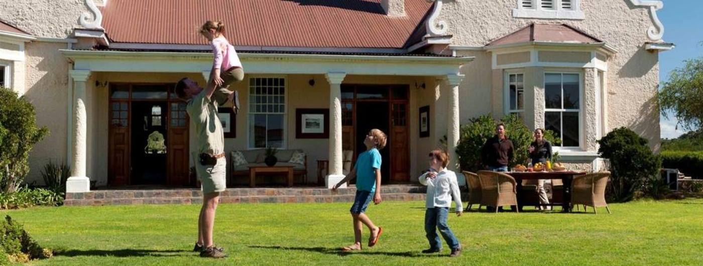 Uplands Homestead family outside house