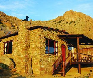 Eagle's Nest Chalets, seamlessly blending with its rugged surroundings