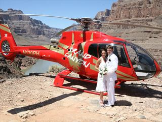 Bride and groom by Helicopter