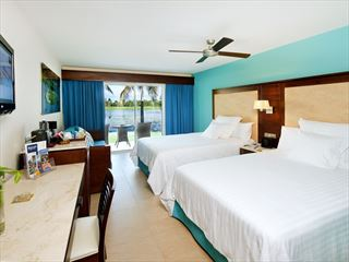 Barcelo Bavaro Palace Deluxe Hotel bedroom with golf-course views