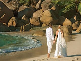 Bride & Groom on the beach at Constance Lemuria