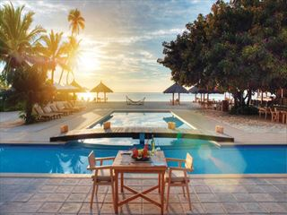 Poolside dining at Desroches Island Resort