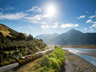 TranzAlpine train alongside the Waimakariri River