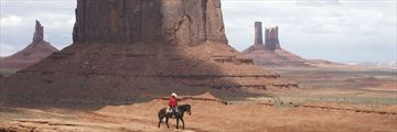 Cowboy journeying through Monument Valley, Arizona