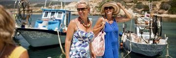 Women walking along the harbour, Cyprus