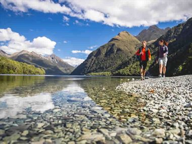 Couple hiking Lake Gunn, Fiordland, South Island, New Zealand