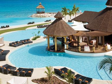 Outdoor pool and sun terrace at Secrets Wild Orchid
