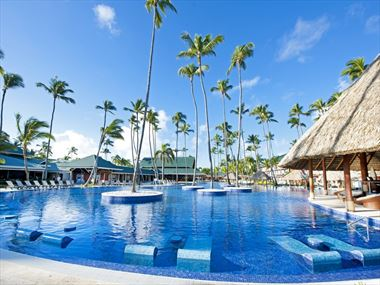 Swimming pool with loungers at Barcelo Bavaro Beach