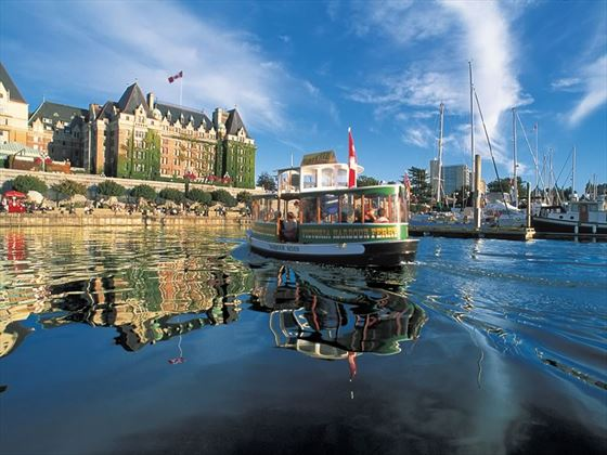 A harbour ferry in front of the Fairmont Empress Hotel, Inner Harbour, Victoria