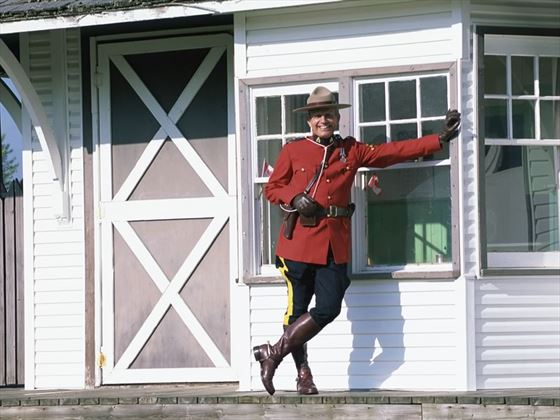 An RCMP police officer in red uniform in Prince George