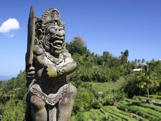 Ancient Balinese statue in rice fields