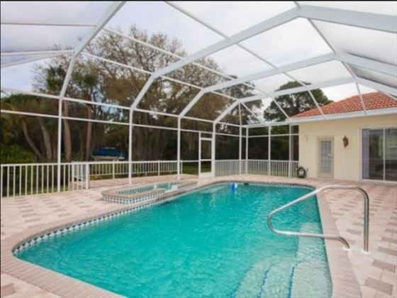 Example of an Englewood Area Home - Private Pool
