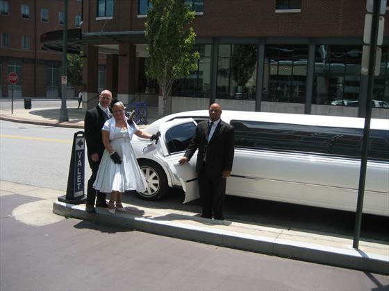 Bride and groom by limo