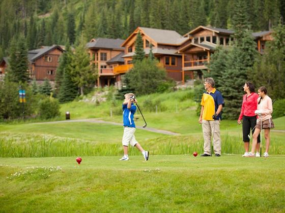 Family playing golf in Sun Peaks. Credit: Royce Sihlis