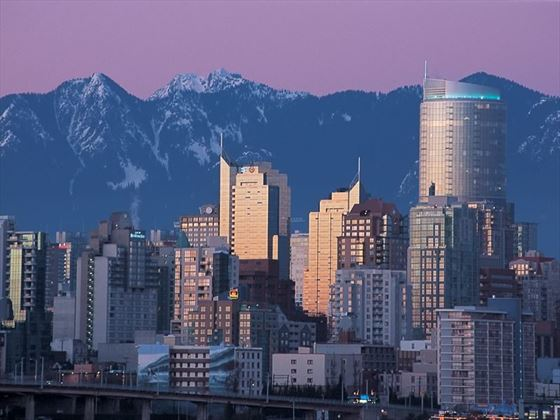 Vancouver skyline against the North Shore Mountains at dusk