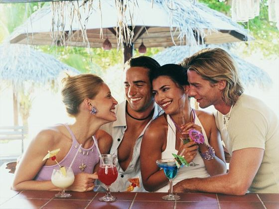 Enjoy cocktails with friends on your adult only vacation