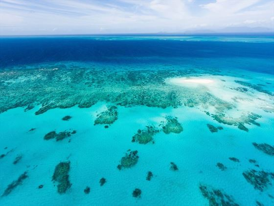 Aerial view of Great Barrier Reef with coral sand cay