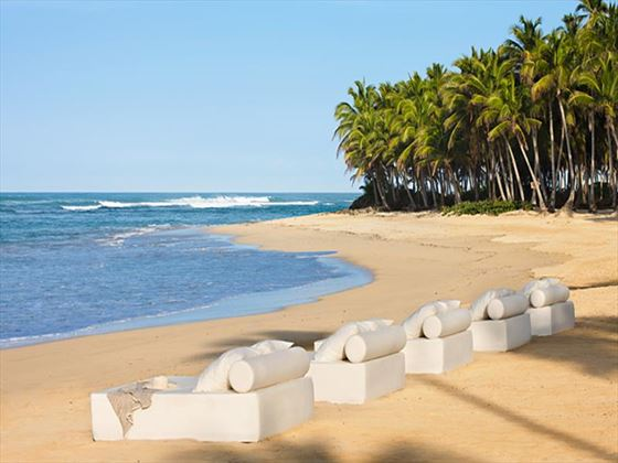 Beachfront seating at Excellence Punta Cana