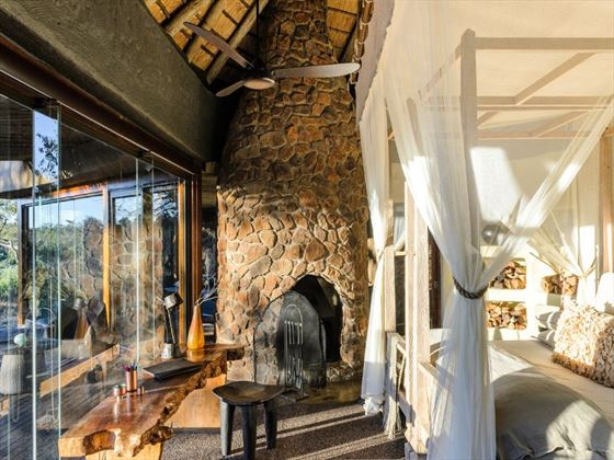 Bedroom and view at Singita Boulders Lodge
