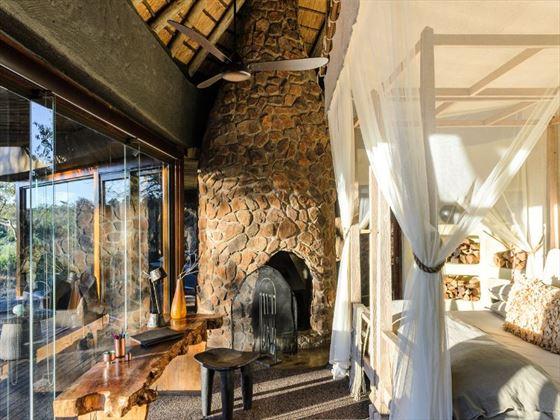 Bedroom and view at Singita Boulders Lodge