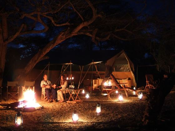 Enjoy camp fires at the Porini Amboseli Sustainable Camp