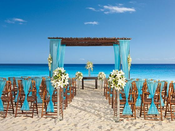 Sugar-white sand and azure waters welcome guests to a beach front wedding at Secrets Capri.