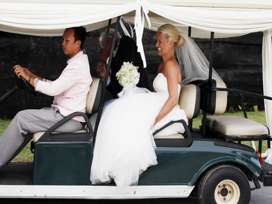 Decorated golf buggy for the Bride
