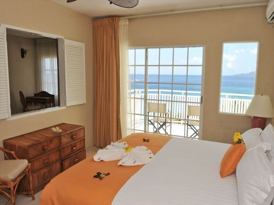 Deluxe bedroom at Grenadian by Rex Resorts