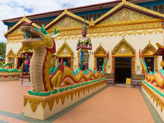 Dragon statues lining the entrance to a temple