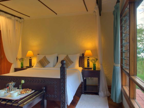 Faru Suite bedroom at Sarova Lion Hill Lodge