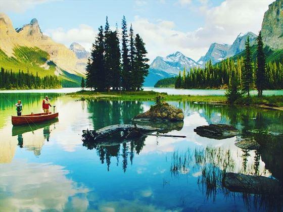 Father and son fishing on Maligne Lake, Alberta