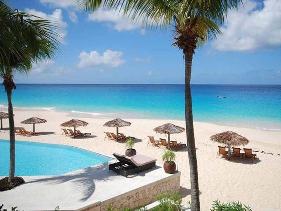 Frangipani Beach Hotel pool and beach view