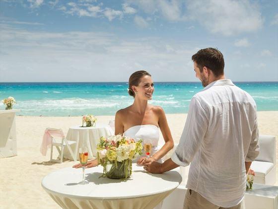 Bride & Groom on the beach at Gran Caribe Resort & Spa