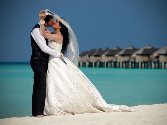 Bride & Groom after renewing their vows at The Sun Siyam Iru Fushi