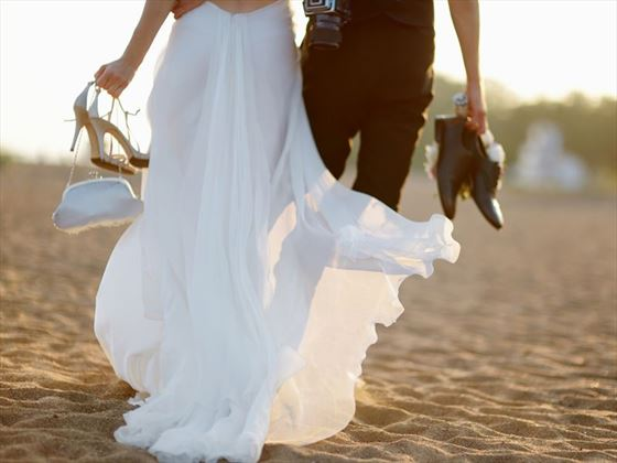 Husband and wife walking together at LUX* South Ari Atoll
