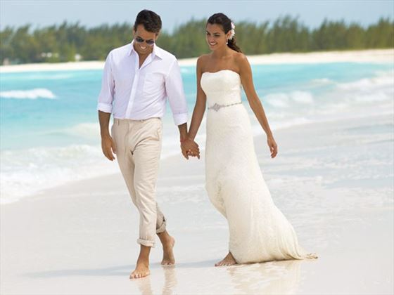 Sandals emerald bay bahamas caribbean wedding tropical sky beautiful beginnings wedding at sandals emerald bay newlyweds walking on the beach junglespirit Gallery