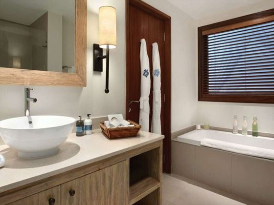 One bedroom suite bathroom at Kempinski Seychelles Resort