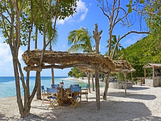Open-air dining at the Beach Bar at Petit St Vincent