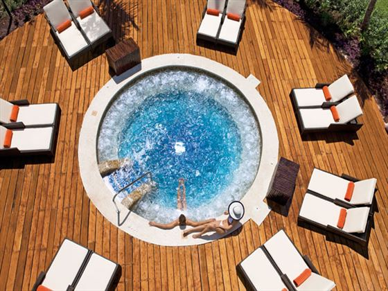 Outdoor Jacuzzi with sun terrace at Dreams Riviera Cancun Resort & Spa