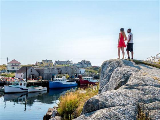 Couple exploring Peggy's Cove, Nova Scotia