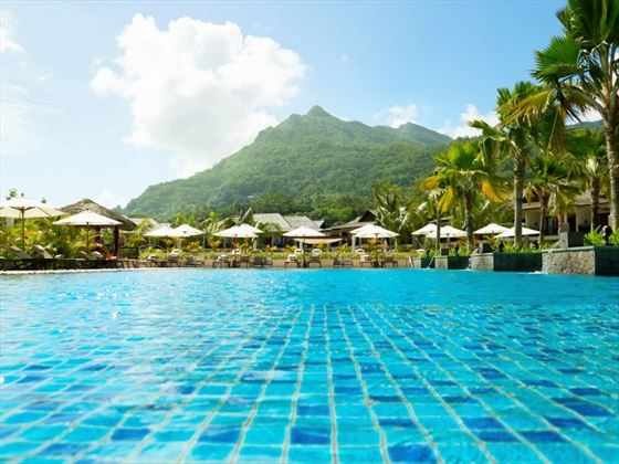 View of outdoor pool and mountains
