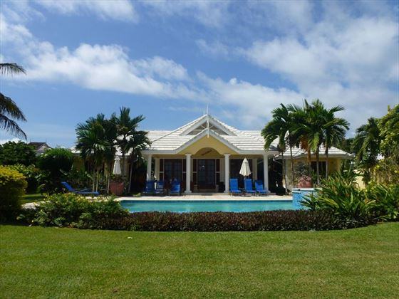 Villa Idleaway garden & pool, located on the oceanfront in Tobago