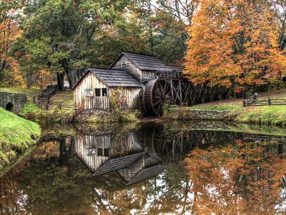Rustic gristmill in the fall