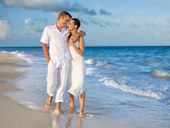 Lovers stroll at Secrets Cap Cana Resort & Spa