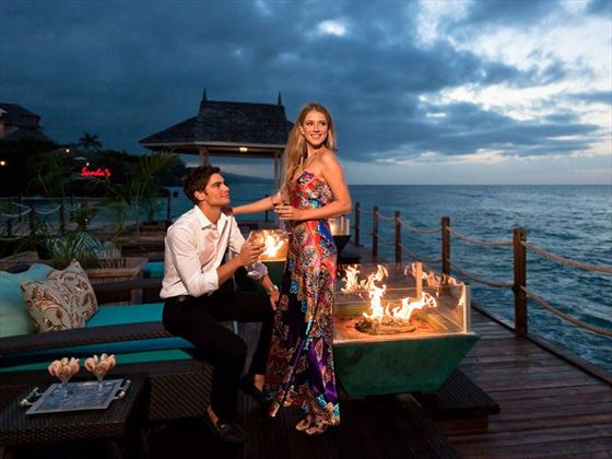 Chic firepits and seating areas along the pier offer pure romance as night falls