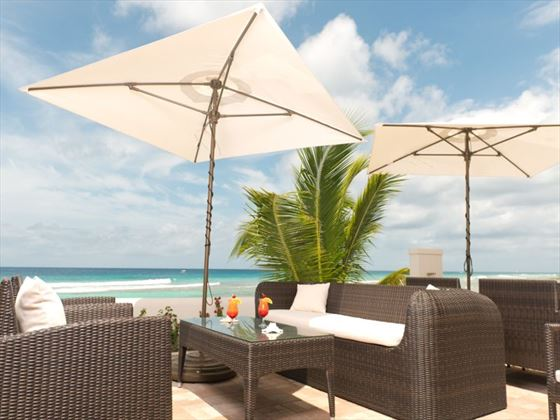 Beachfront lounge area at The SoCo Hotel