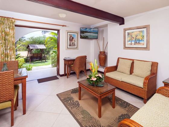 Garden View Suite living room at Sugar Cane Club Resort & Spa