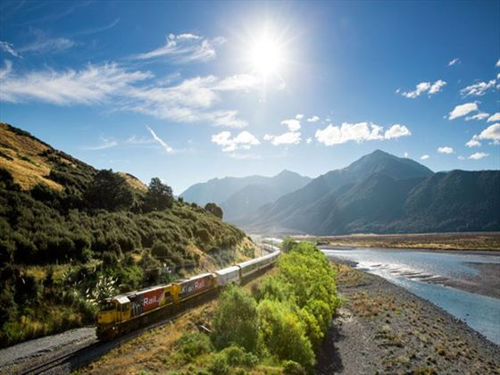 TranzAlpine train alongside the Waimakariri River