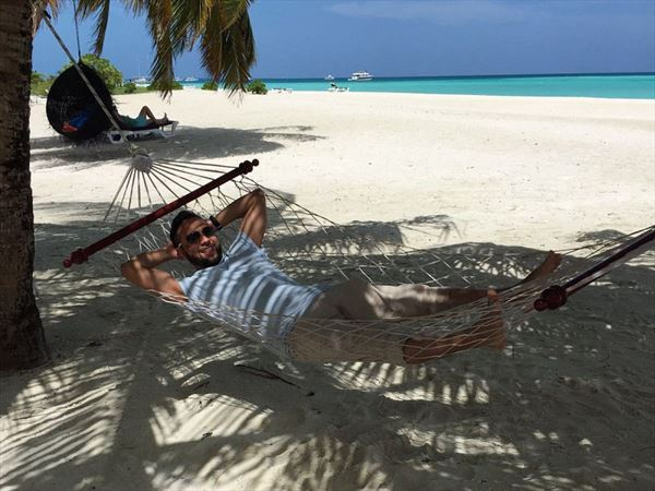 relaxing in a hammock at meeru