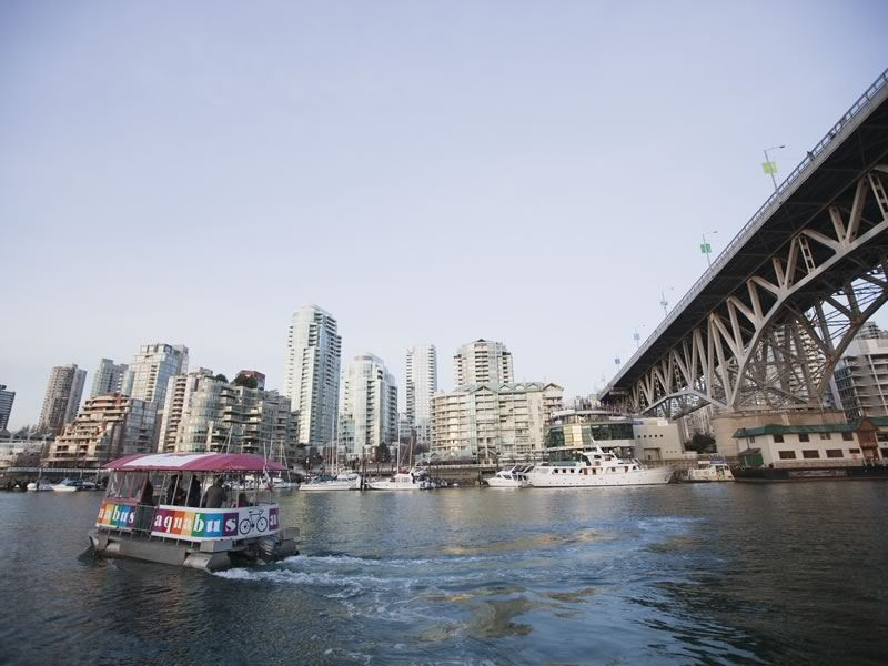 Aquabus crossing False Creek near the Granville Street Bridge in Vancouver